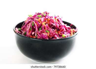 red cabbage coleslaw in bowl on white