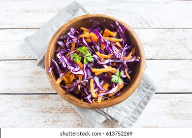 Red Cabbage Coleslaw Salad with Carrots and Greens - healthy diet, detox, vegan, vegetarian, vegetable spring salad, copy space for text
