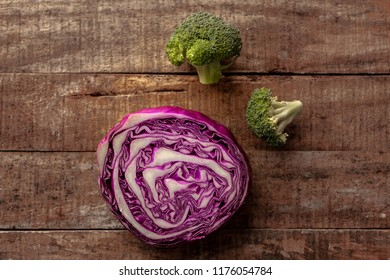 red cabbage on oranage wood background.