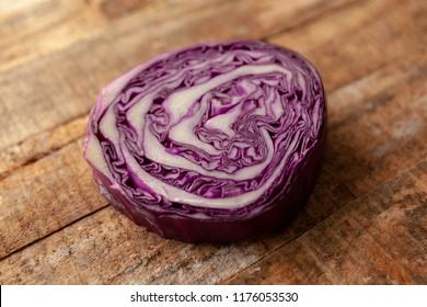 red cabbage on orange wood background.