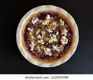 Red cabbage quiche with goat cheese and sunflower seeds