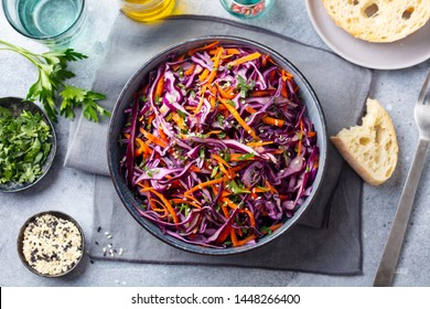 Red cabbage salad, Coleslaw in a bowl. Grey background. Top view.
