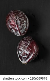 red cabbages on a black background