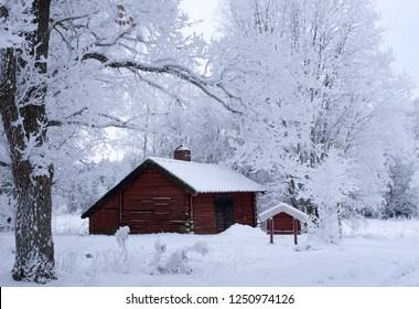 Red cabin in a frosty landscape