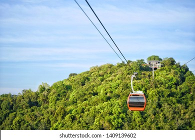 Red cable car Hat Yai City, mountain cable car in Kho Hong, Songkhla, Thailand. Beautiful blue sky and scenic view. No people.