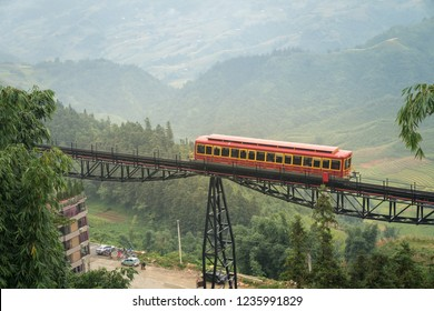 Red cable car to the top of the Fansipan mountain in Sapa town, Lao Cai, Vietnam