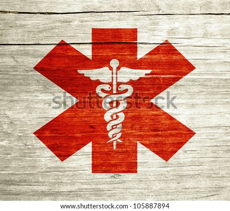 Red Caduceus on wood with grunge design