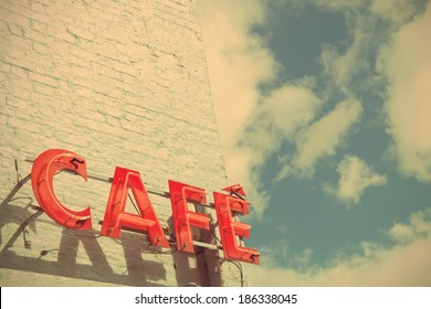Red Cafe Sign Against Blue Sky with a Retro Effect
