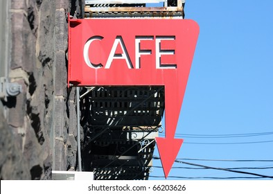 Red cafe sign with an arrow