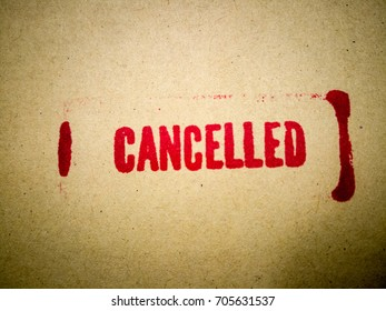 Red CANCELLED rubber stamp carton texture background. Fail business concept. Vintage tone.