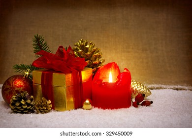Red candle ,gift box ,Christmas ball and  decoration.Christmas decoration and white snow.