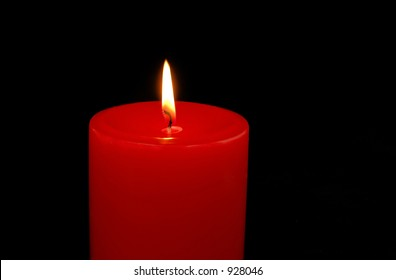 Red Candle isolated on black