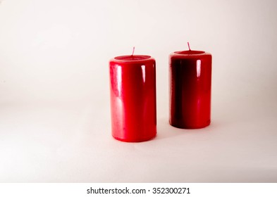 Red candle isolated on white background