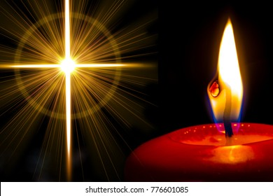 a red candle shines next to a cross of golden light