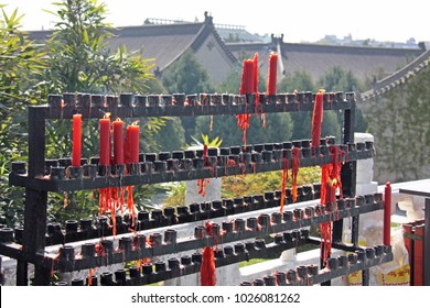 Red candles in a Chinese temple. China.