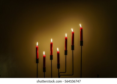 red candles on a chandelier