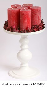 red candles on a stand