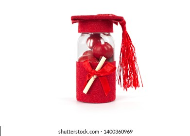 red candy in jar with bow