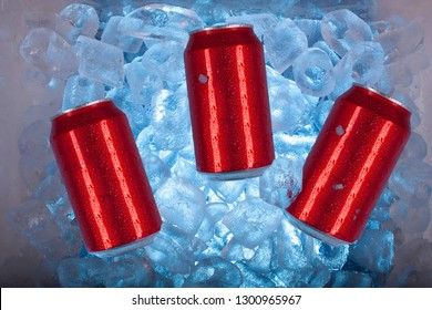 Red cans inside cool ice cooler surrounded by blue ice cubes ready for field day in Mexico