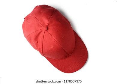 Red cap isolated on white background, top view.