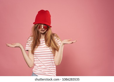 red cap on the head of a woman