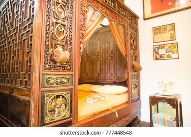 RED CAPITAL RESIDENCE, BEIJING, CHINA, 2016: ancient Chinese style teakwood bed in Red Capital Residence Hotel, Beijing