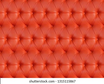 Red capitone checkered coach leather textile background, retro Chesterfield seamless texture, furniture diamond pattern decoration with buttons. Rouge tufted fabric wallpaper.