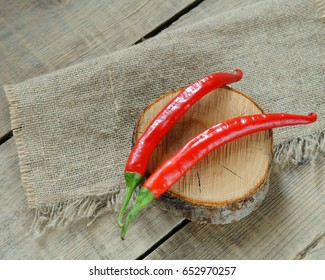 Red capsicum. Bitter pepper. Burning red pepper. Two red peppers on burlap