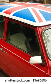 Red car with english flag on roof