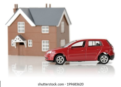 a red car and house isolated on a white background