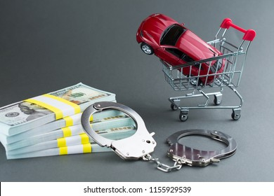 Red car  money handcuffs. shopping for vehicles fraud car sale scam  breaking the law car dealer concept.