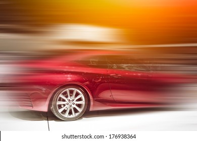 Red car in the motion