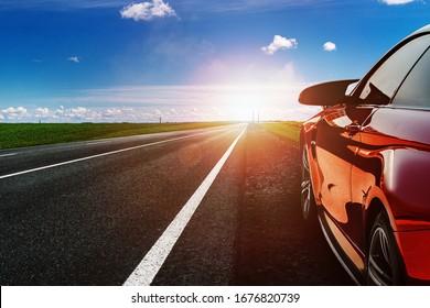 red car on asphalt road