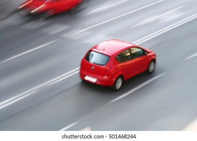 Red car on a road