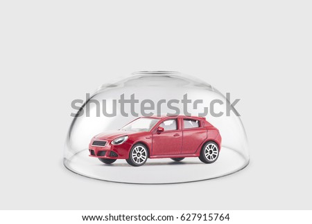 Red car protected under a glass dome