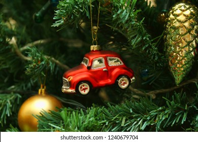 Red car toy, cone and ball, decorations on Christmas tree