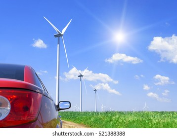 Red car and wind turbines generating electricity.