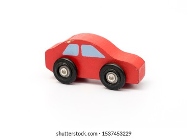 red car wood toy on white