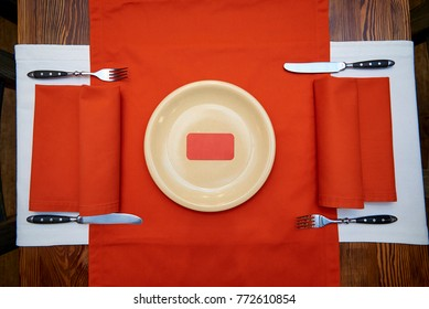 Red card is on a plate on a serving table