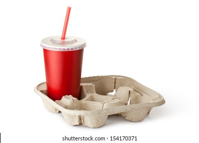 Red cardboard cup in the cup holder. Isolated on a white.