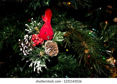 Red Cardinal Christmas Ornament and Snowy Pinecones on a Christmas Tree