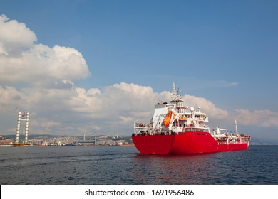 red cargo ship in the Gulf of izmit is moving