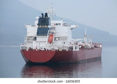 A red cargo tanker seen from the stern