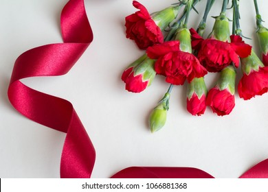 Red Carnation Flower and Red Ribbon Mother's Day Image