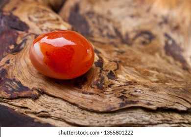 Red Carnelian against wooden background