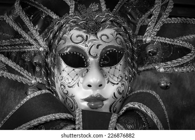 red carnival mask, black and white image