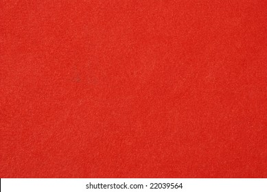The red carpet background and texture.