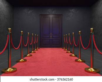 Red carpet between two rope barriers