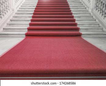 Red carpet on a stairway used to mark the route taken by heads of state, vips and celebrities on ceremonial and formal occasions or events