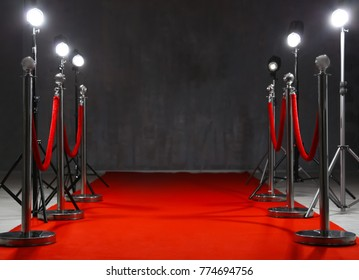 Red carpet and rope barriers indoors